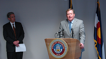 US Attorney John F. Walsh III and former DEA Denver Field Office Director Kevin R. Merrill announce a bust