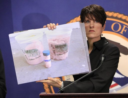 US Attorney Laura Duffey holds up the deadly menace: pot cotton cancy