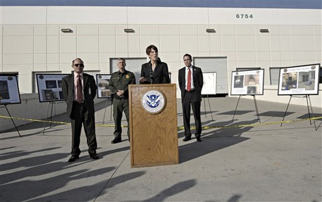 US Attorney Laura Duffey at a podium announcing the uncovering of a drug tunnel between Tijuana and a San Diego warehouse