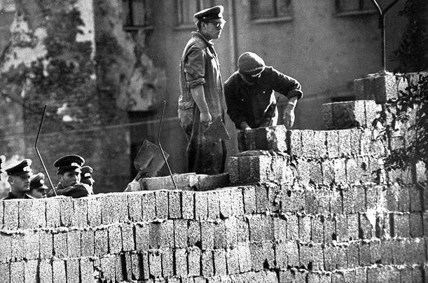 building the Berlin Wall brick by brick